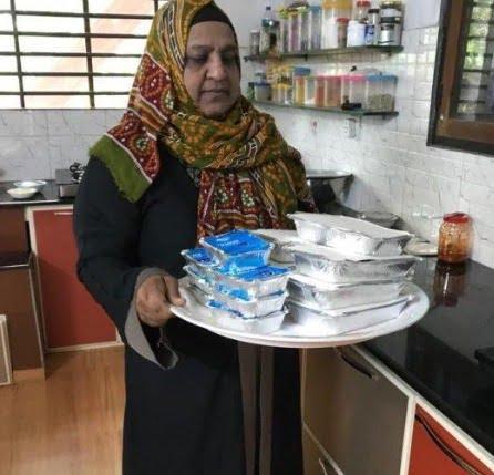 Sunita Khader Carrying Food