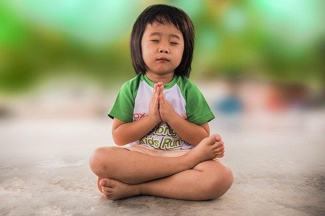 Little girl praying - must learn soft skills