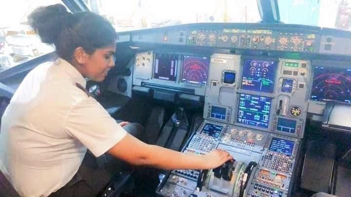 Jeni Jerome Pilot operating cockpit